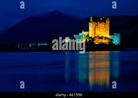 Illuminated Eilean Donan Castle, near Dornie, Highlands, Scotland, Great Britain - Stock Photo