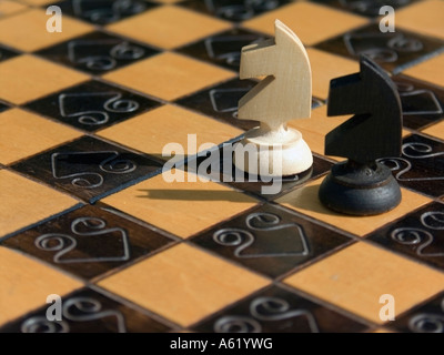Chessman two balck and white Knights - Stock Photo
