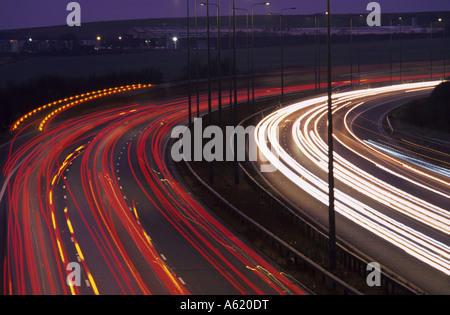 traffic headlight trails at dusk on the M62 Leeds Yorkshire UK - Stock Photo