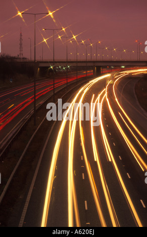 traffic headlight trails on the M62 at dusk Leeds Yorkshire UK - Stock Photo