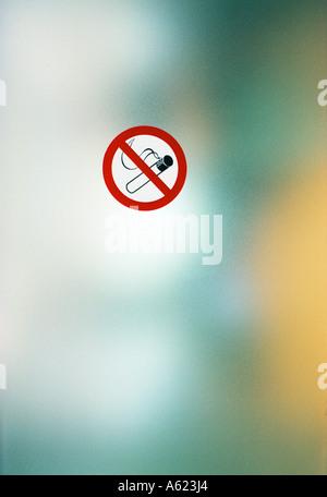 Close-up of No Smoking sign board - Stock Photo