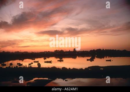 Fishing boats in river during sunset, San Fernando, Cadiz, Cadiz Province, Andalusia, Spain - Stock Photo