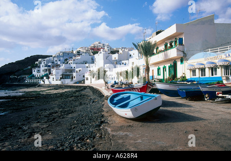 Boats and houses on the coast - Stock Photo