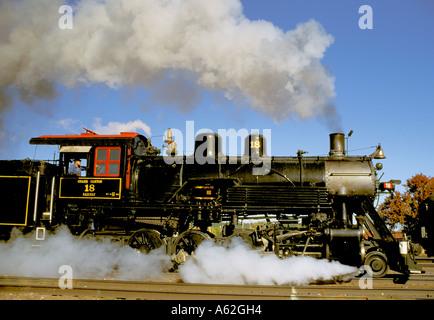 Smoke emitting from steam locomotive engine - Stock Photo