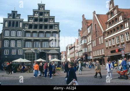 Large group of people walking in street, Luneburg, Saxony, Germany, Europe - Stock Photo