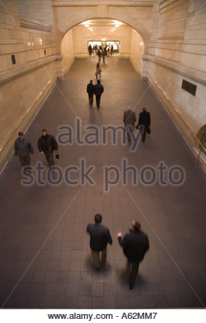 commuters walking through an large hallway in Grand Central train station New York City - Stock Photo