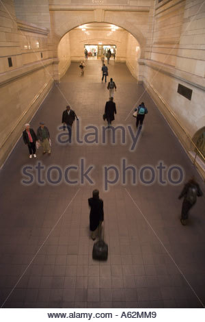 commuters walking through an large hallway Grand Central New York City - Stock Photo