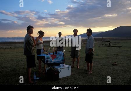Tourists enjoying a drink at sunset Lake Manyara National Park Tanzania - Stock Photo
