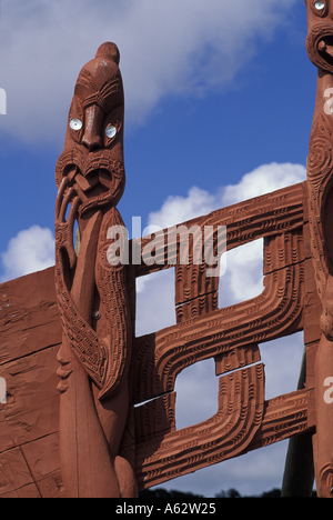 New Zealand Maori carvings adorn a meeting house near the Waitangi National Reserve along the Bay of Islands  - Stock Photo