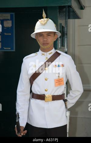 Police or Army Guard at Grand Palace complex Bangkok Thailand - Stock Photo
