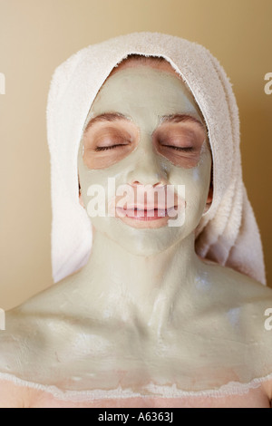 Close-up of a mid adult woman having a facial - Stock Photo