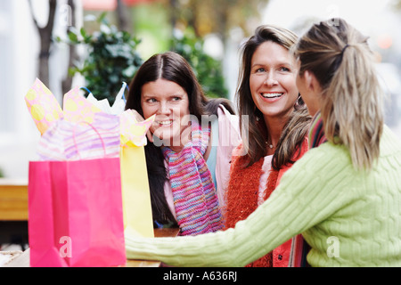 Close-up of three young women smiling - Stock Photo