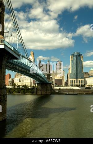 Roebling Suspension Bridge Crosses the Ohio River from Covington in Northern Kentucky into Downtown Cincinnati - Stock Photo