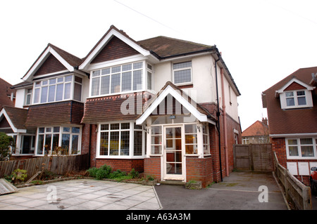 A TYPICAL SEMI DETACHED HOUSE IN A SUBURBAN STREET UK - Stock Photo