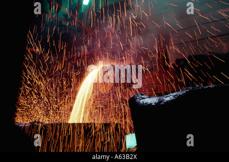 Sparks fly in the MMC Norilsk Nickel smelter in the Artic Circle city of Norilsk located in the Krasnoyarsk Krai - Stock Photo