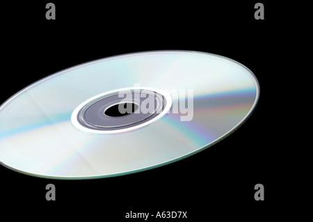 Single DVD on isolated blackbackground - Stock Photo