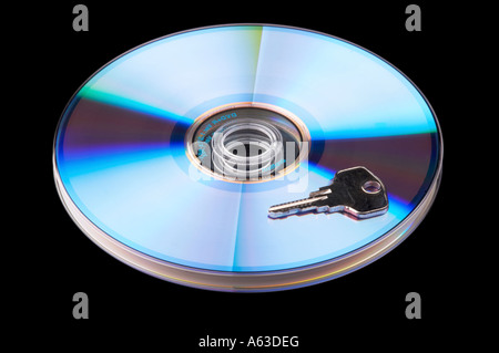 Concept data security, single DVD with key isolated on black baclground - Stock Photo