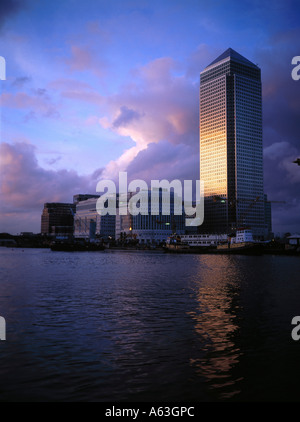 Buildings at waterfront, Canary Wharf, Thames River, London, England - Stock Photo
