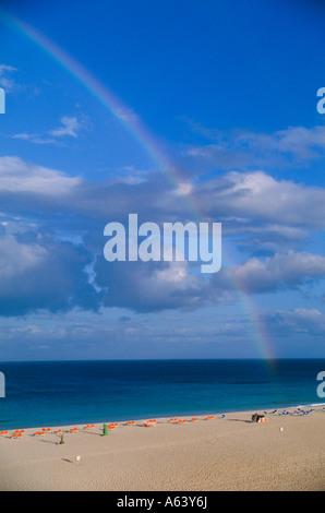 rainbow at beach at evening near village of corralejo island of fuerteventura canary islands spain - Stock Photo