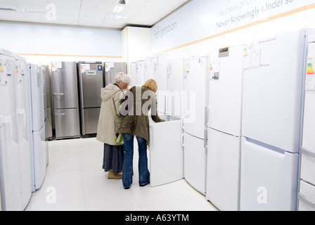 Women looking at new refrigerators in John Lewis, London, England, UK - Stock Photo