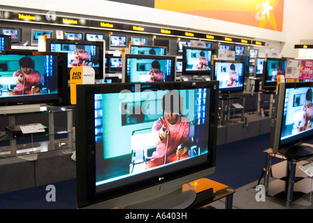 Rows of televisions for sale in Comet store, England, UK - Stock Photo
