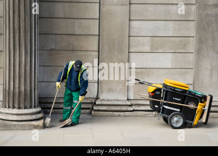 Street sweeper working in the City of London, England, UK - Stock Photo