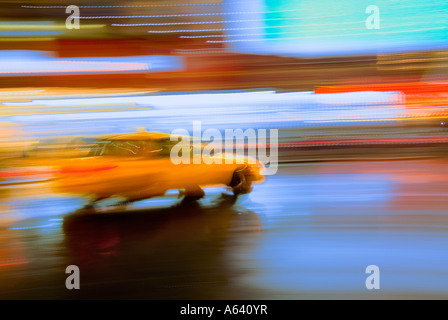 Taxi Cab, New York City At Night With Motion Blur And Bright Lights, Times Square, New York City, USA - Stock Photo