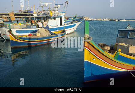 Fishing boats in the harbour of Marsaxlokk, Malta - Stock Photo