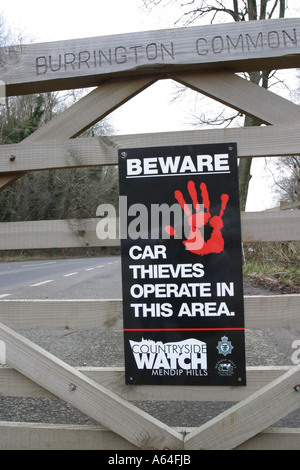 Police theft warning sign in countryside car park in Mendip Hills somerset England - Stock Photo