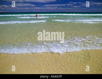 woman at beach near village of corralejo island of fuerteventura canary islands spain - Stock Photo