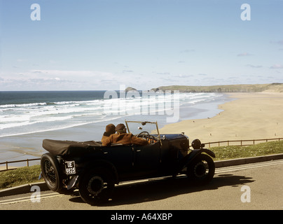 Couple in a Riley 9 car at Perranporth exploring the north coast of Cornwall, pastimes, retirement, U.K. - Stock Photo