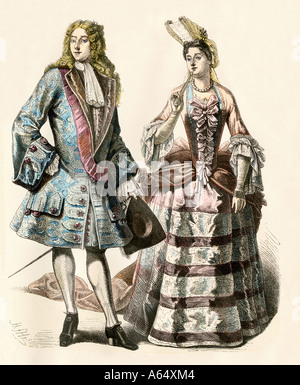 Gentleman and lady of Louis XIVs court France early 1700s. Hand-colored print - Stock Photo
