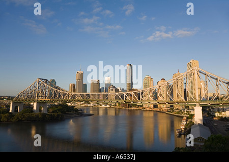 Early morning light on Brisbane's Story Bridge and central business district along the Brisbane River waterfront - Stock Photo