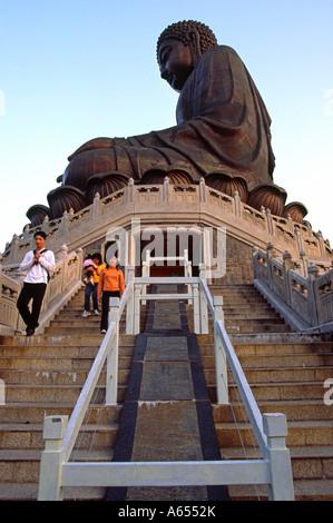 Tourists descend the 260 steps leading to the giant Tian Tan Buddha at Ngong Ping on Lantau Island Hong Kong - Stock Photo