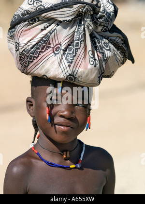 A young Himba girl at Opuwo an important administrative centre of the Himba Her hair is plaited in the traditional - Stock Photo