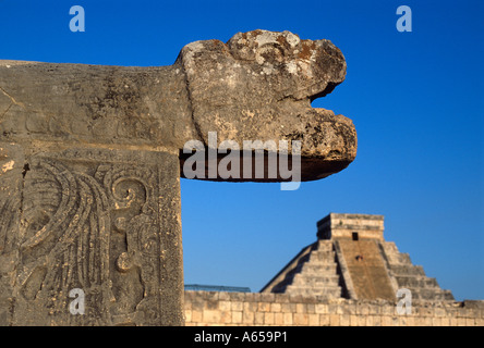 Serpent head sculpture and El Castillo pyramid Mayan ruins, Chichen Itza, Yucatan, Mexico - Stock Photo