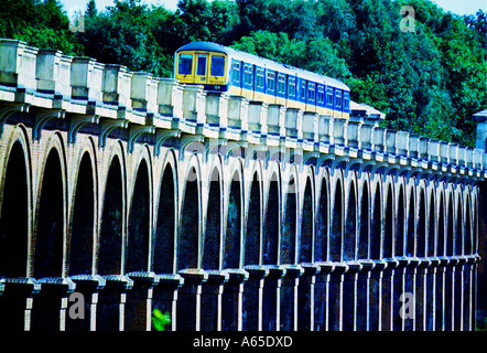 A Thameslink Brighton to Bedford train crossing the Ouse Valley Viaduct near Balcombe Sussex
