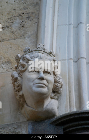 Queen Elizabeth II bust on left side of entrance to Chichester Cathedral, West Sussex, UK. - Stock Photo