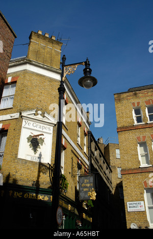 View of Shepherd Market and Ye Grapes pub in Mayfair London England - Stock Photo