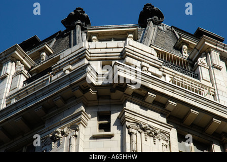 Two figures on top of the Regent Palace Hotel near Piccadilly Circus London - Stock Photo