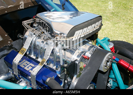 supercharger and injection hat on top of a high power drag racing V8 engine - Stock Photo