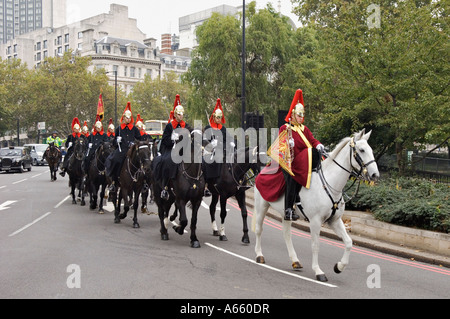 The Queen's Cavalry Riding from Hyde Park Barracks to Buckingham Palace in London England - Stock Photo