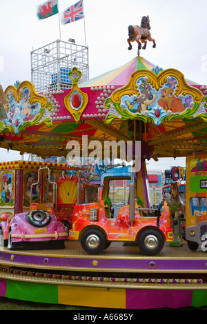 Collins travelling fair Ghost Train and childrens amusement rides for enjoyment and entertainment - Stock Photo