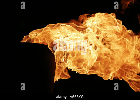 [Chimney fire], bright orange flames blowing against [black background], 'close up' detail - Stock Photo