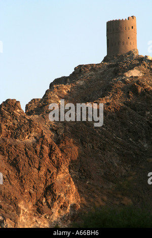 A watchtower on top of a mountain overlooking Muscat, Oman - Stock Photo