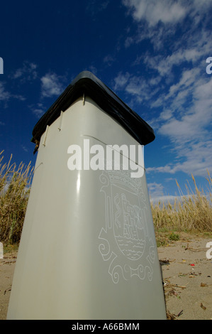An image a of a spanish bin on the beach in spain on a hot day bins are often found on beaches in southern spain - Stock Photo