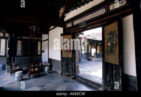 Vista through opened doors on one of the courtyards of Zhu Family Garden (Zhujia Huayuan) in Jianshui. China. - Stock Photo