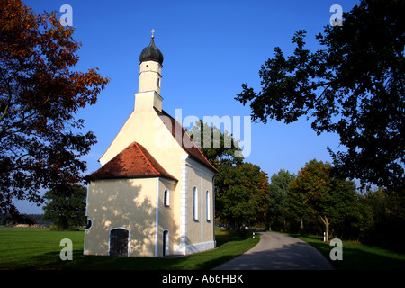 little church along side a country road in bavaria germany - Stock Photo