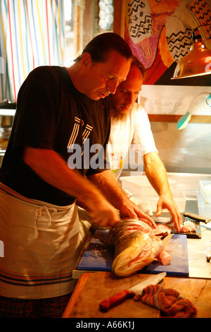 chef Nicola the owners of Playa De Los Artistas restaurant working in the kitchen Montezuma Nicoya peninsula Costa - Stock Photo