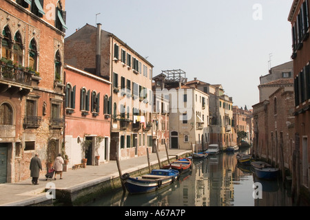 Canal through Venice in the afternoon sun - Stock Photo